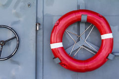 Life buoy. On the battleship wall, a protective equipment in case of drowning, safety concept royalty free stock image