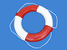 Life buoy. A blue and white life buoy on a blue background Stock Images