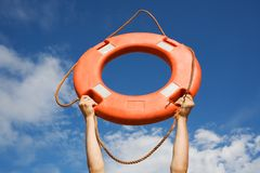 Life buoy. Ring in man's hands on a background of the sky Royalty Free Stock Photography