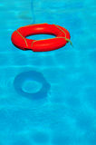 Life buoy. On turquoise pool water Royalty Free Stock Photo