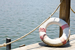 Life buoy attached dock. Stock Photography