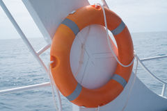 Life buoy attached to the cruise ship royalty free stock photos