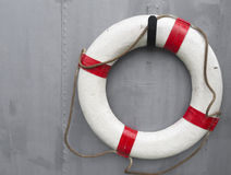 Life buoy. Attached to a metal wall on a ship Royalty Free Stock Photography