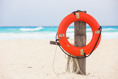 Life buoy. Attached to a wooden post at the beach in Mexico Stock Images