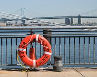 Life buoy from Battleship New Jersey. Life ring buoy from the battleship  USS New jersey with Benjamin Franklin Bridge in background Royalty Free Stock Photo