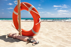 Life buoy on the beach. royalty free stock photography