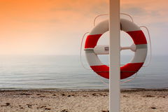 Life buoy on the beach Stock Photography