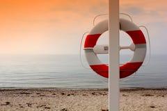 Life buoy on the beach Stock Photography
