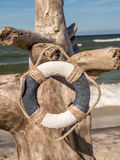 Life buoy on the beach Royalty Free Stock Image