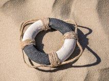 Life buoy on the beach Royalty Free Stock Photo