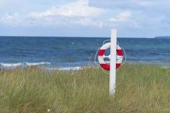 Life buoy on beach Royalty Free Stock Photography