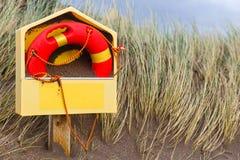 Life buoy on the beach Royalty Free Stock Photography