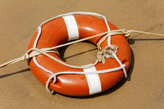 Life buoy on beach sand Stock Photos