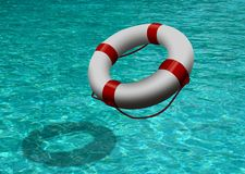 Life buoy on blue water Royalty Free Stock Photo