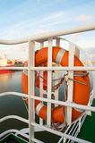 Life buoy on boat in harbor Royalty Free Stock Images