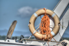 Life buoy on a boat side in hdr Royalty Free Stock Photography