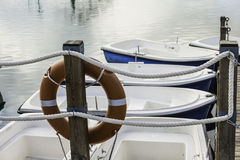 Life buoy an boats in the pier Royalty Free Stock Images