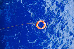 Life buoy bound with rope rescue floating in the sea. Life buoy bound with rope rescue floating in the blue sea Stock Images