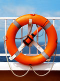 Life buoy on deck of a ship. Against the ocean background Stock Images