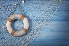 Life buoy decoration. On blue shabby background Royalty Free Stock Image
