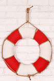 Life buoy. Decorative life buoy hanging on a brick wall Stock Photo