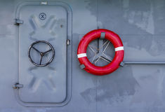 Life buoy and door Royalty Free Stock Photography