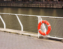 Life buoy on embankment for help and assistance Royalty Free Stock Photos
