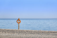 Life buoy on an empty beach Royalty Free Stock Image