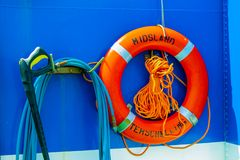 Life buoy hanging on a boat. stock photos