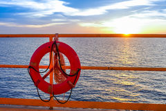 Life buoy hanging on the handrail of offshore platform. stock image