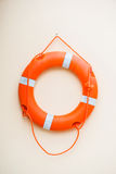 Life buoy hanging on the wall r Royalty Free Stock Photography