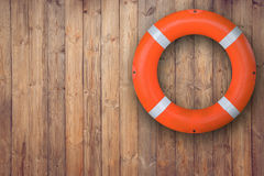 Life buoy hanging on wooden wall for emergency response when people sinking to water almost place near pool and beach. Life buoy hanging on wooden wall for Royalty Free Stock Image