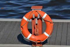 Life buoy in a harbor Royalty Free Stock Photo