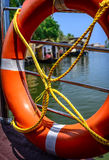 Life buoy in a harbor. Royalty Free Stock Image