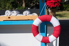 Life buoy or lifesaver, hanging at swimming pool. Stock Photography