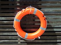 Life buoy, lifesaver at the wooden wall Royalty Free Stock Images