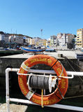Life buoy - Malpica Bergantinos - Spain. Life buoy in port of Malpica de Bergantiños. Malpica de Bergantiños is a municipality of northwestern Spain in the Royalty Free Stock Photography