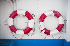 Life buoy. On metal ship wall Stock Images