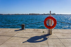 Life buoy next to a lake Royalty Free Stock Photos