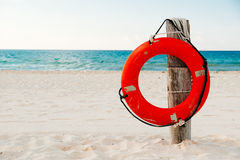 Life buoy on a pole on a beach in Mexico Royalty Free Stock Photo