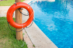 Life buoy on a pole next to a pool, Mexico 2015 Stock Image