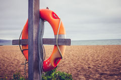 Life buoy on post at the beach Royalty Free Stock Photography
