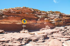 Life Buoy at Pot Alley. Yellow life buoy preserve on stand in the coastal sandstone formations at Pot Alley gorge under clear blue skies in Kalbarri, Western stock photo