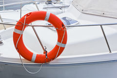Life buoy. Red life buoy on white boat Royalty Free Stock Photos