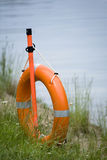 Life buoy ring on coast. Of river Stock Photos