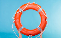 Life buoy ring in female hands stock photography