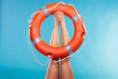 Life buoy ring on female legs Royalty Free Stock Photos