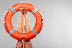 Life buoy ring on female legs Royalty Free Stock Images