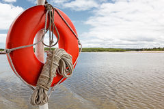 Life buoy and rope on boat stock photo