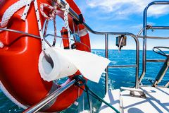 Life buoy with ropes and toilet paper on boat Royalty Free Stock Photo